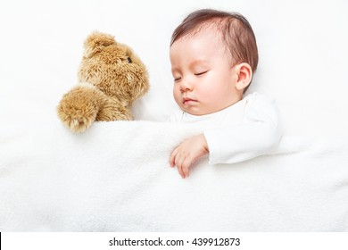 My Best Friend the baby sleeping with her teddy bear on the bed, New family and baby healthy concept
