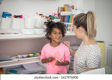 My day with a teacher. Child in preschool.