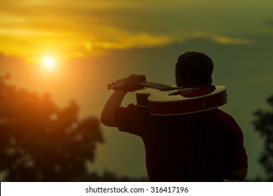 My dream the guitar man on silhouette sunset background