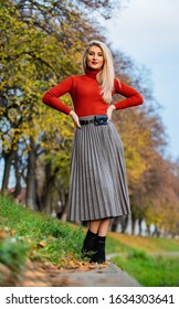 It is my fall style. Clothing features. Must have skirt. Trendy girl wear midi skirt. Pleated skirt collection. Blonde enjoy cozy outfit nature background. Inspiring outfit. Femininity natural beauty.