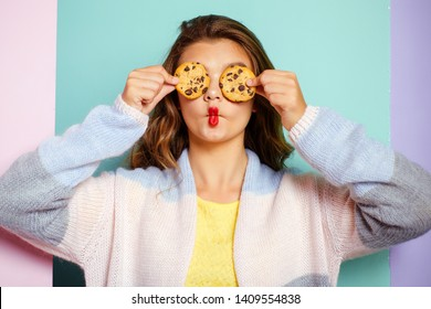 My favorite cookies. Pretty girl covering eyes with cookies. Bakery style chocolate chip cookie recipe. Cute girl having fun with cookies. Following a cooking recipe. Bakery shop.