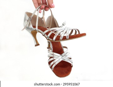 My favorite silver dancing shoes with high heels with white in the background