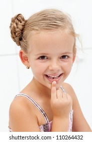 My first encounter with the tooth fairy - young girl showing missing teeth