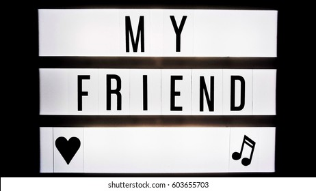 My friend text in balck and white on light box sign board