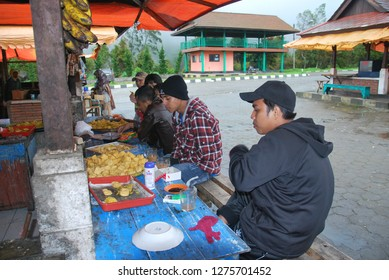 my friends eat and drink at warung or traditional shop in java indonesia. photo taken in may 2011