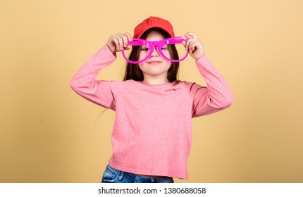 My goggles as unique as me. Cute smal child with fashion goggles accessory. Adorable little girl wearing fancy goggles. Finding the perfect goggles frame for her.