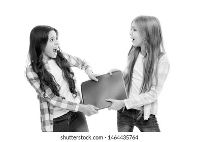 Its my homework. Small pupils cant share homework diary and record book among them. Naughty schoolgirls in school homework club. Little school children fighting over homework assignment.