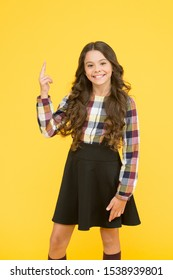 My idea. Little child pointing finger up yellow background. Adorable schoolgirl got idea. Expressing smart idea. Lets consider the idea. School time. Education.