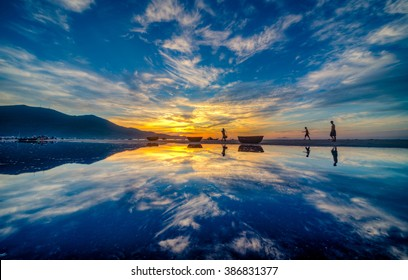 My Khe beach is a beautiful beach in Danang city ,  Vietnam.  The sunrise was reflected in the pond bond before the beach. My Khe Beach is in  Top 6 beautiful beach in the World By Forbes Magazine.
