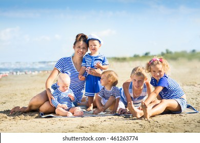 My mother with five children on the beach