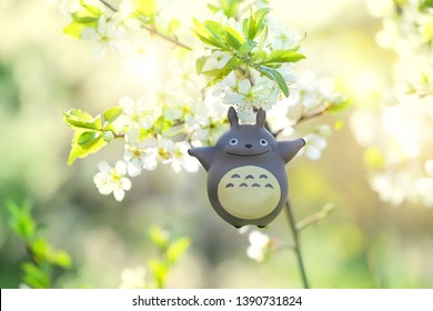 My Neighbor Totoro. toy Totoro, character from anime of Hayao Miyazaki. toy Totoro on blurred nature spring background. Russia, Moscow, May 2019