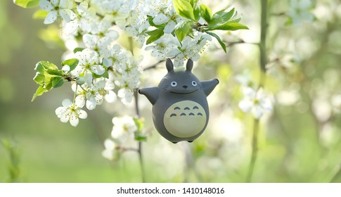 My Neighbor Totoro. toy Totoro, character from anime of Hayao Miyazaki. toy Totoro on blurred nature spring background. soft focus. Russia, Moscow, May 2019