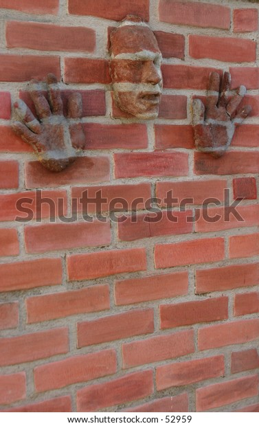 """my original artwork, titled """"Urban Camouflage"""" my face and hands (made out of paper mache') on a z-brick wall"""