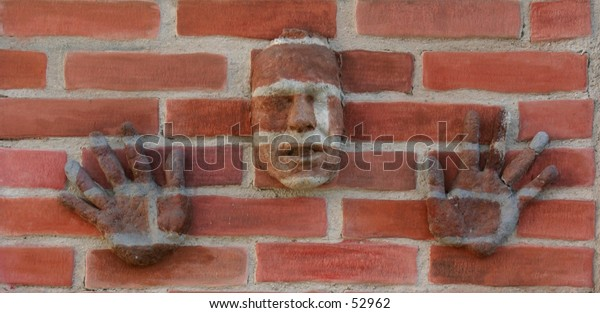 """my origional artwork, titled """"Urban Camouflage"""" my face and hands (made out of paper mache') on a z-brick wall"""