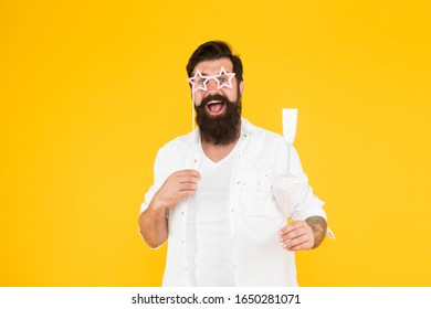 It is my party mood. Pretend like its real party. Cheers. Bearded man hipster yellow background. Valentines day holiday. Happy birthday. Brutal man with beard romantic date. Party booth props.