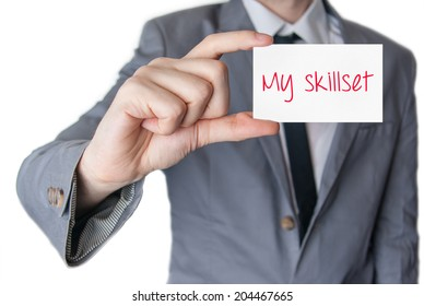 My skillset. Businessman in suit with a black tie showing or holding business card
