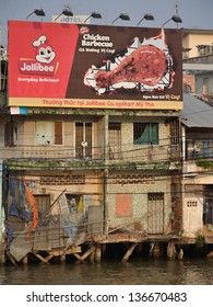 MY THO, VIETNAM - FEBRUARY 13: Billboard of Jollibee, Filipino multinational chain of fast food restaurants, on the bank of Mekong on February 13, 2012 in My Tho, Vietnam.