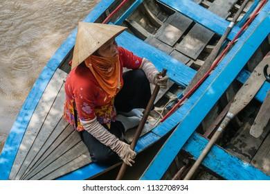My Tho, Vietnam - Sep 10, 2017 : Vietnamese farmer waiting tourist coming in sampan boat on muddy river at Mekong Delta jungle cruise, the most popular attraction for the tourists around Ho Chi Minh.