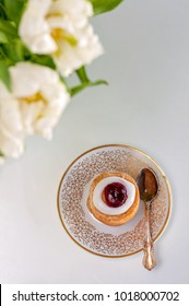 It's my time! Runeberg's tart or cake is a Finnish traditional dessert and pastry, white tulips on the foreground.