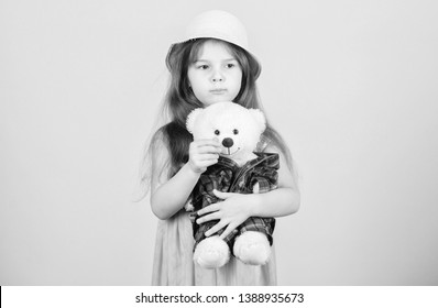 Its my toy. Small child cuddling teddy bear toy. Adorable girl child with cute stuffed animal doll. Little girl holding soft toy. Toy is used in play.