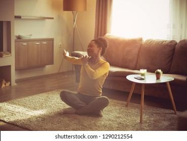 My way to relaxing at home. African American woman working exercise at home.