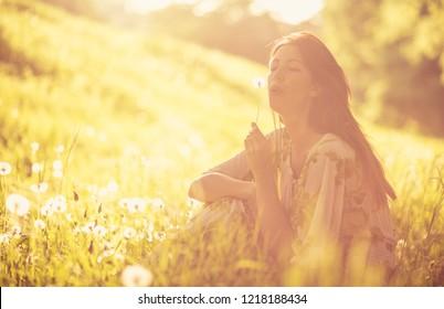 My wish. Beautiful young woman enjoy in nature.