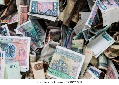 Myanmar Banknote in donation box from tourist