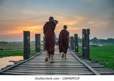 Myanmar Buddhist monks.The monks walking on the wooden bridge,sunset time,Mandalay, Myanmar.