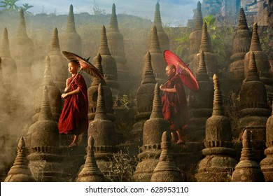 [MYANMAR] Buddhist novice monk are walking in pagoda,myanmar