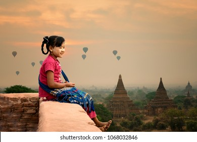 Myanmar girl smiling on the pagoda at Bagan Mandalay Burma.