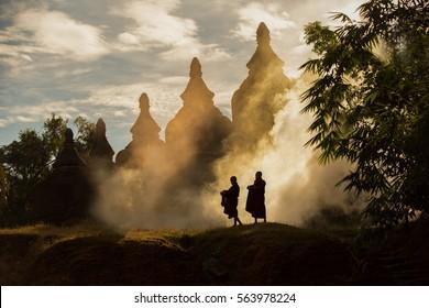 [MYANMAR] little monk myanmar stay outdoors , pagoda background