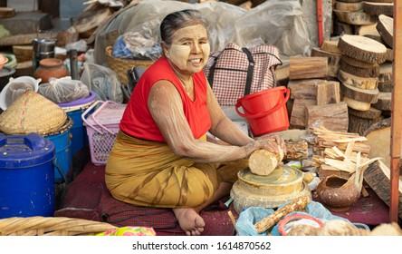 Myanmar , Mandalay  on May 7,2019 :Burmese beauty and tanaka at Mandalay market.Thanaka is a wood bark traditional make up base, & conditioning natural sun screen.