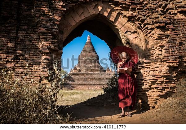 Myanmar monk reading a book at old Bagan, Myanmar.