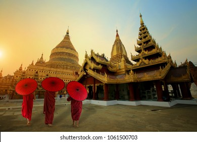 MYANMAR Novice monks walking around the sacred Shwezigon Paya At Golden pagoda in Mandalay Myanmar(Burma)