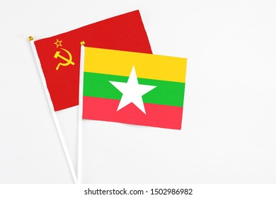 Myanmar and Soviet Union stick flags on white background. High quality fabric, miniature national flag. Peaceful global concept.White floor for copy space.