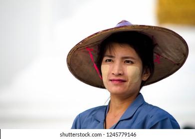 Myanmar, Yangon. November 28, 2018 : Burmese woman with tanaka paste on her face.