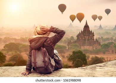 Myanmar, Young hipster woman traveller backpacker sitting watch Beautiful landscape Bagan Mandalay ancient pagoda in Bagan, Mandalay Myanmar. Beautiful landmark of Asia.