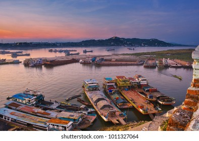 Myanmar,Mandalay, river boats being loaded   bamboo in the small harbor in  Mandalay,