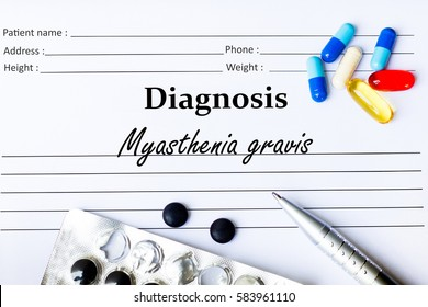 Myasthenia gravis -  Diagnosis written on a piece of white paper with medication and Pills