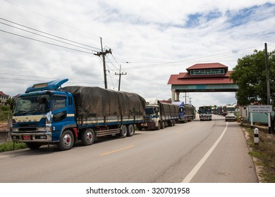 MYAWADDY MYANMAR - SEP26 : Rows of trucks on the hight way to Yangon around the Myawaddy Trade zone import inspection, Karen state, Myanmar on SEPTEMBER26, 2015