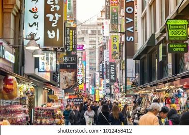 MYEONG DONG, SEOUL, SOUTH KOREA - APRIL 1, 2016 : Tourist at Myeong-dong shopping street, Seoul, South Korea
