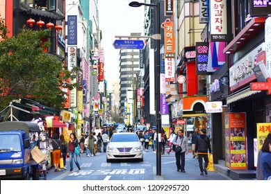 Myeongdong road on day time,street shopping or shopping area packed with international fashion brands at Seoul,South Korea with people are walking on the autumn season.Oct 22,2018 : South Korea.