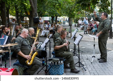 Mykolaiv, Ukraine - August 24, 2019. The military orchestra plays old national music for the elderly on Independence Day of Ukraine in the central park. Older people dance to music and remember youth.