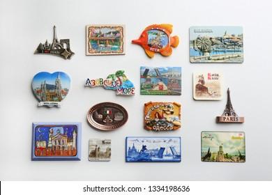 MYKOLAIV, UKRAINE - DECEMBER 24, 2018: Many different travel magnets on light background