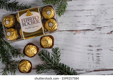 Mykolaiv Ukraine - December 27, 2019. Ferrero Italian chocolates in gold foil, this is a wonderful gift for Christmas and New Year for your dear people. Sweets that children and adults love.