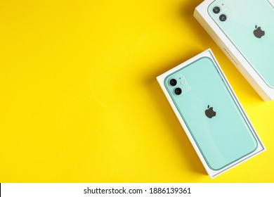 MYKOLAIV, UKRAINE - JULY 10, 2020: New modern Iphone 11 Green in original box on yellow background, flat lay. Space for text