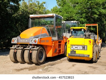 MYKOLAIV, UKRAINE - July 13, 2016: Special road machinery for asphalting construction works on a side of a road.