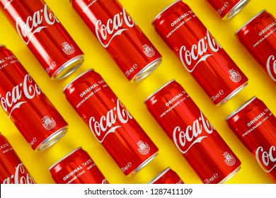 MYKOLAIV, UKRAINE - NOVEMBER 14, 2018: Coca-Cola cans on color background, flat lay