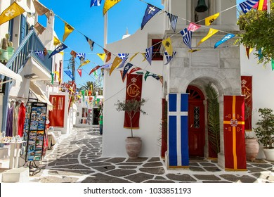 Mykonos: 04 -July   Greek orthodox Church celebrating  its patron Saint's day. Decorated with flags. Mykonos, Greece July 6 2013.