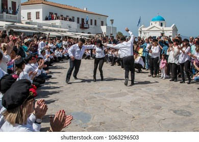 Mykonos, Cyclades/ Greece-April 1 2018: Mykonos dancers perform the syrtaki on Palm Sunday